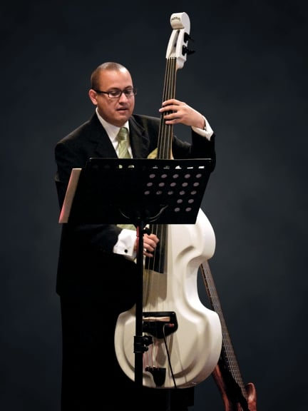 Daniel Menjívar playing Baby Bass